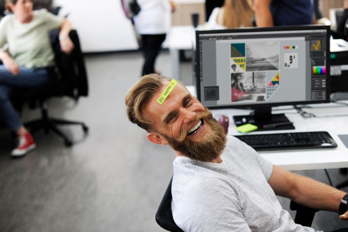 Man Having Be Happy Sticky Note on Forehead During Office Break